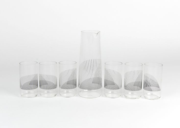 Mexican designer Liliana Ovalle has created a carafe and set of tumblers printed with fine black lines that overlap to create a moiré effect when the pieces are clustered together.