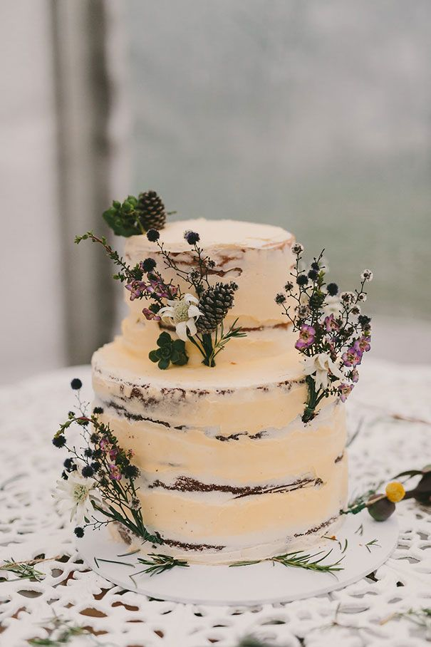 Beautiful naked cake with greenery and flower details