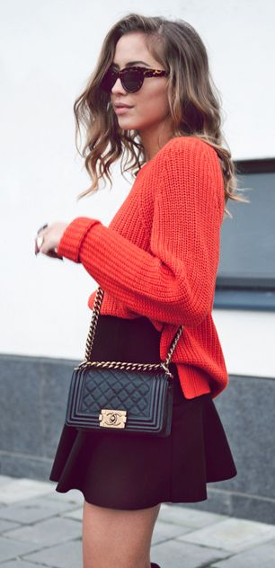 Kenza Zouiten is wearing mandarin red knitwear from Vila