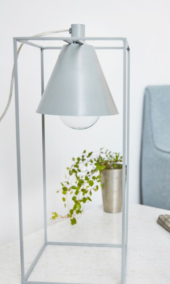 Novelty Lamp. With Kubix, House Doctor has created an exciting and interesting table lamp with a contemporary and modern feel to it. The table lamp consists of a classic steel lampshade with a white interior.