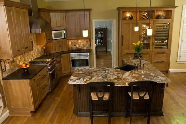 The shape of this kitchen I think would be great for your house. Plenty of cooking & entertaining space. Island, wedge shape and lights above look awesome!