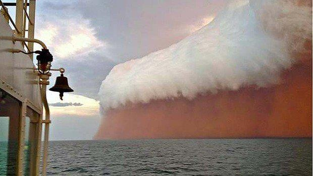 "Nature's wrath ... a spectacular gust front associated with cyclone Narelle was captured about 25 nautical miles north-west of Onslow in Western Australia on Wednesday. The red tinge results from dust picked up from the Pilbara."" [photo: Brett Martin / smh.com.au]"