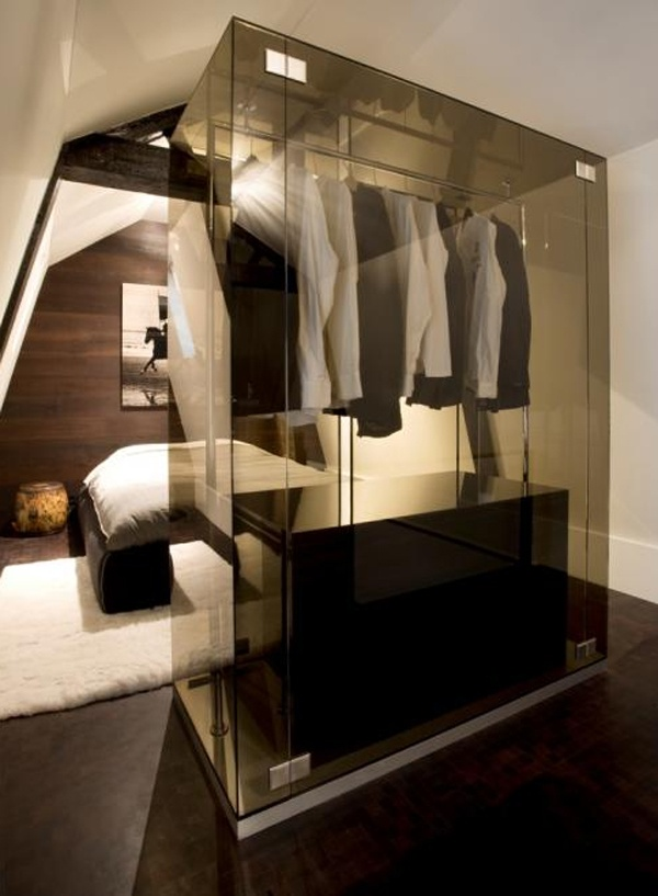 When it comes to closet cool, I don't think it gets much better than this. Designed by the Amsterdam based interior design duo Jeroom Jansen and Bertel Grote of Grand & Johnson, there is just something, oh so James Bond, about this smokey glass closest...