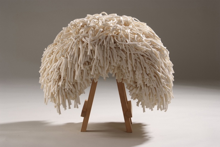CONCEPT    Respecting nature.    A stool which invites you to sit and rub through the material.    It's very cuddly!