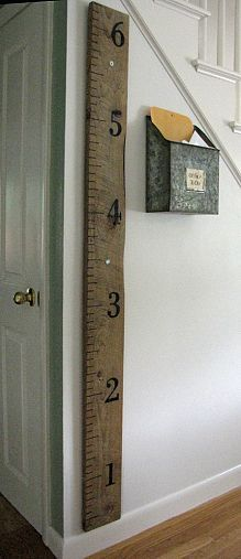 Make your own rustic wall ruler-even though the kids are older, get records from the ped. and go back in time:):