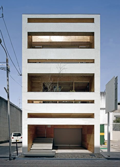"""Japanese Architecture      ArchitectKeisuke Maeda explains that there """"were very few openings"""" in the walls before the renovation, so he created horizontal slices through the front and rear facades to bring in more daylight.        Timber boards line walls andceilings throughout the house, and a new staircase connects the rooms on the first floor with bedrooms and balconies upstairs.        A garage occupies the ground floor, so residents enter the house at first f"""