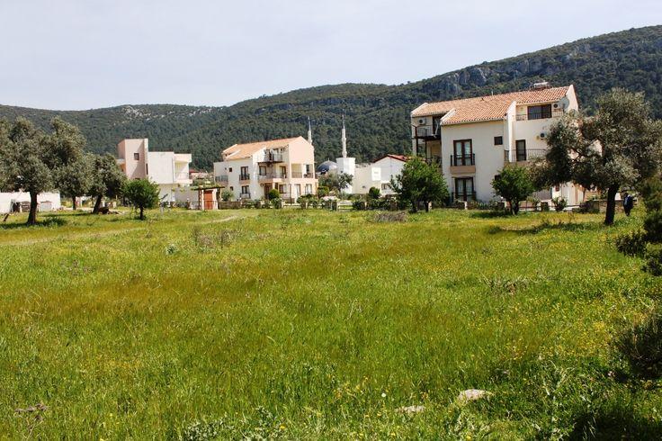 Building Land For Sale In Akbuk Overlooking Parkland. Visit https://www.spotblue.com/turkey-property-for-sale/land-in-akbuk-alt453/ or email info@spotblue.com for more information.