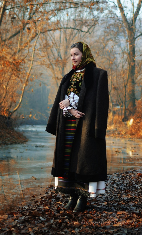 By the old river by Silvia Floarea, via 500px. 2011.   Magdi is wearing a traditional Romanian costume for married women (Transylvania). All garments are handmade and very old.