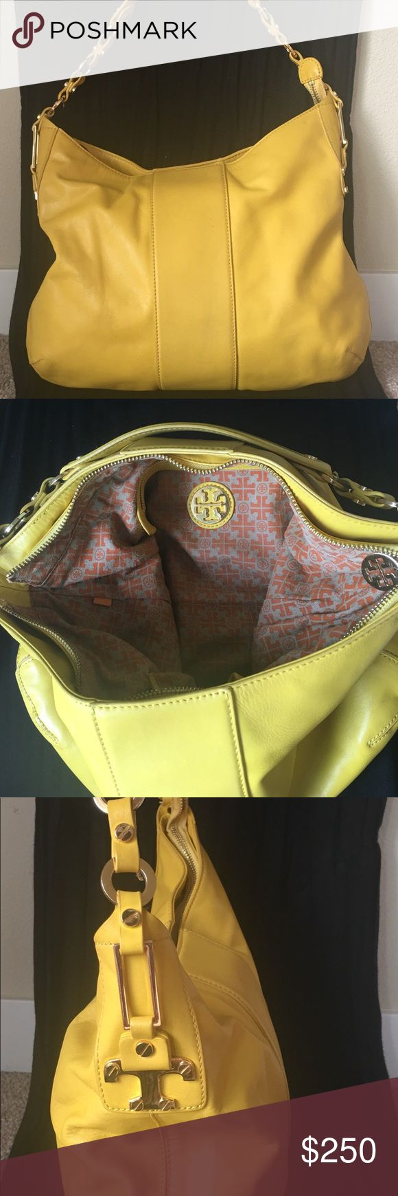 Tory Burch bag with matching wallet! Pre owned authentic Tory Burch hand bag with matching yellow wallet by Beckon. Both in great condition. There is sign of normal wear to both items but no damage or discoloration to either.  Yellow color with gold hardware. There is one large interior zipper pocket and two smaller pockets on the opposite side. Comes with original dust bag.  Prompt shipping!🤗 (Open to reasonable offers!) Tory Burch Bags Shoulder Bags