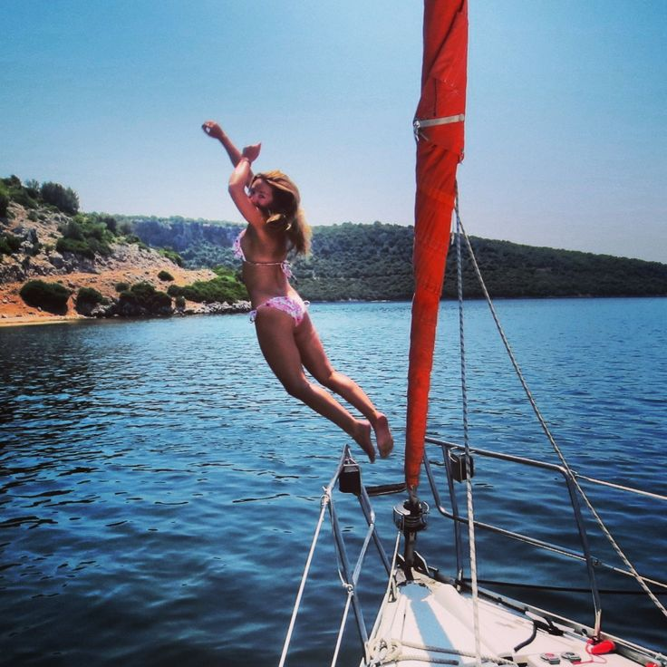 Ionian Flotilla Sailing - Girl jumping from the boat