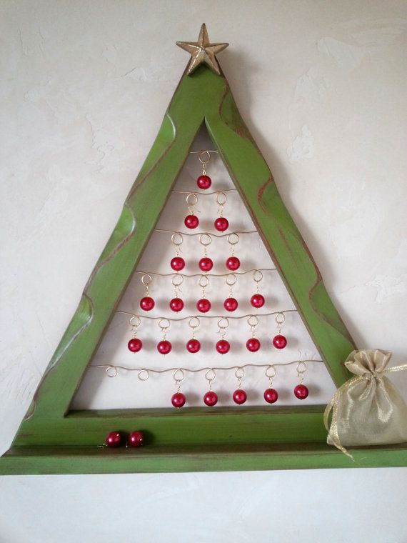Etsy.com *Dont miss out on this amazing sale price!! These frames are being discontinued once current inventory is sold....  Count down the days till Christmas with this beautiful rustic handmade Advent Calendar. Red pearls shimmer like ornaments on the wire loops. A small shelf on the bottom hold the pearls until they are placed on the tree. Traditional countdown is 24 days....the Silver cast iron STAR can be placed at the top as an option to for the 25th day.
