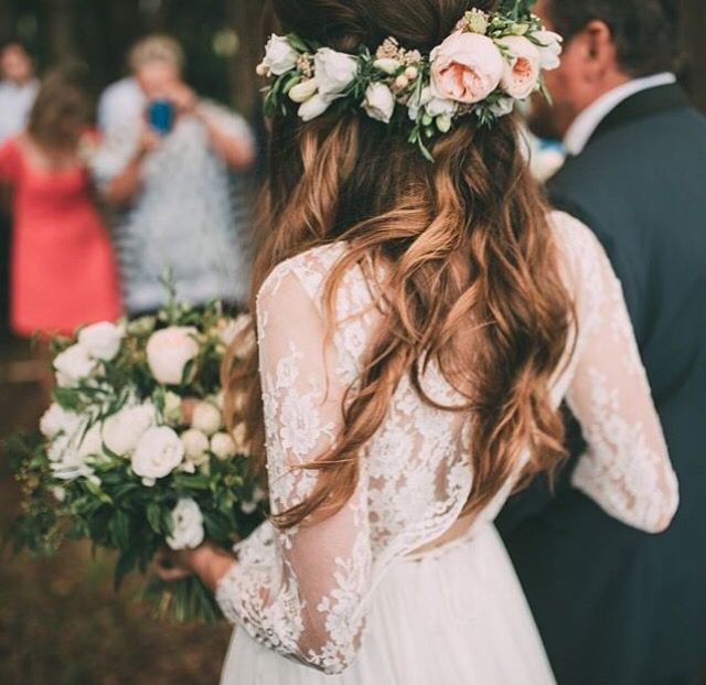Bridal hair with bohemian waves and floral crown.