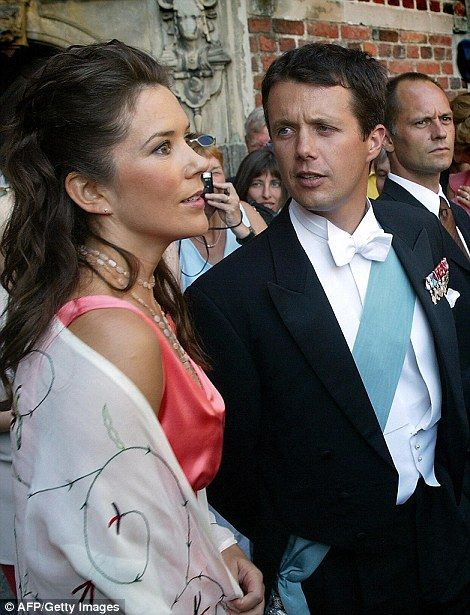 The transformation: A glamorous Princess Mary and husband Prince Frederik pictured in 2002...