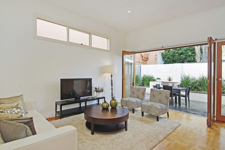 Neutral, sophisticated modern living room meets the patio.