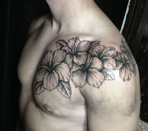 men flower tattoo on shoulder