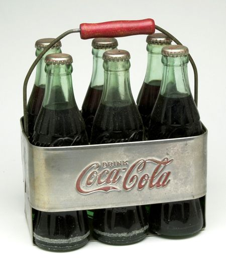 1950's Coca-Cola aluminum six pack carrier, complete with bottles.
