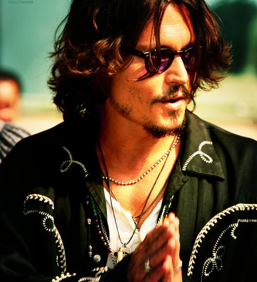 Ok, this may be creeperish, but we all have that one thing, and this is one of my many, reasons I love Johnny Depp. He's very humble, and an actor that gives back. One of his expressions of thanks is he folds his hands and does a little head-bob when he receives a compliment! <3
