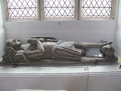 St Mary`s Church and the Waldegrave Chapel - Bures St. Marys -  very rare wooden effigy of a knight, complete with mail coat, mail hose and knee cops, sword belt and part of sword, legs crossed and feet spurred, with lion at his feet, and angels supporting the cushion beneath his head. The effigy is carved in sweet chestnut, and dates from about 1330. Its identity cannot be proven as there are no identification marks, but it is almost certain that it represents Sir Richard De Cornard.
