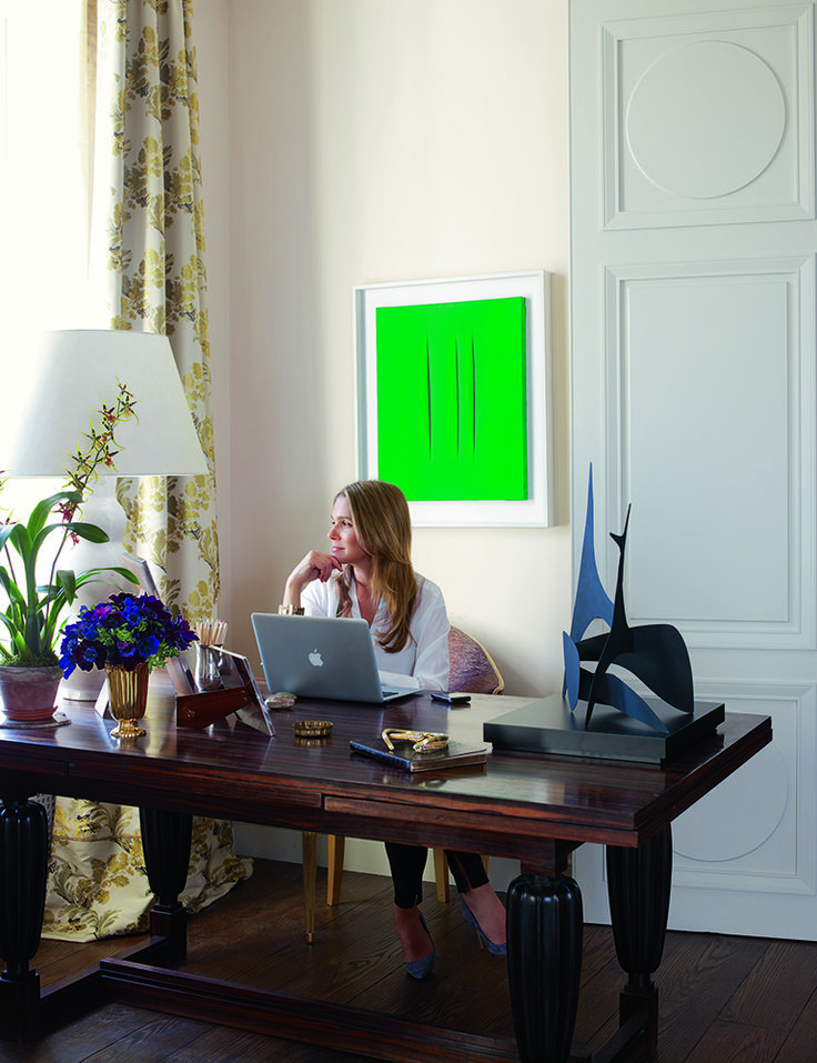 Self proclaimed lifestyle architect Aerin Lauder at home on Park Ave, where a Lucio Fontana canvas brightens her work area. Photo by Simon Upton.