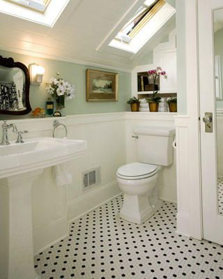 Beautiful sea glass green and white.  Fantastic skylights. Inviting touches like the oil painting, daisies and antique mirror. Pretty old fashioned black and white tile floor.