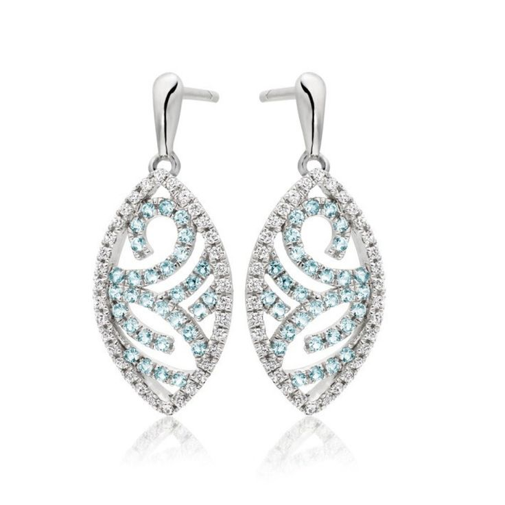 Sky Drop Earring ll Shimmering #diamond and delicate #topaz stones emulate the moment that light breaks through the clouds on a cool, blue day, in the sumptuous Sky Drop collection. Elegantly curving, the white gold setting represents the curvature of the horizon where the heavens meet the earth. shardsoflondon.com  #Jewellery #Jewelry