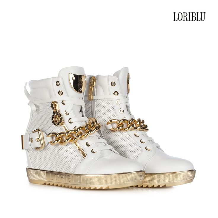 Pierced white leather wedge sneaker. Hard rock style that doesn't go unnoticed.