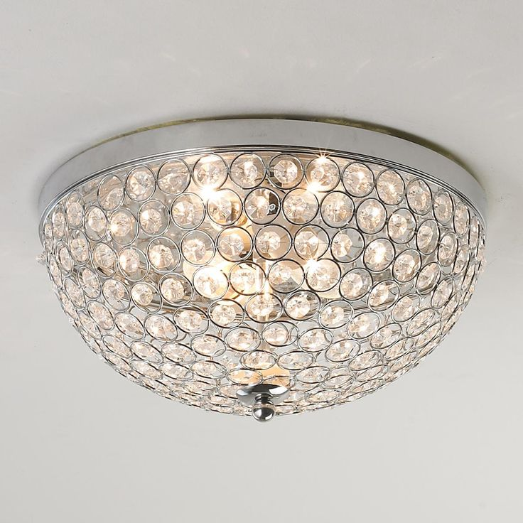 Crystal Jewel Ceiling Light Chrome circles frame hundreds of cut crystal jewels in this flush mount ceiling light producing intimate reflections on the ceiling and walls.