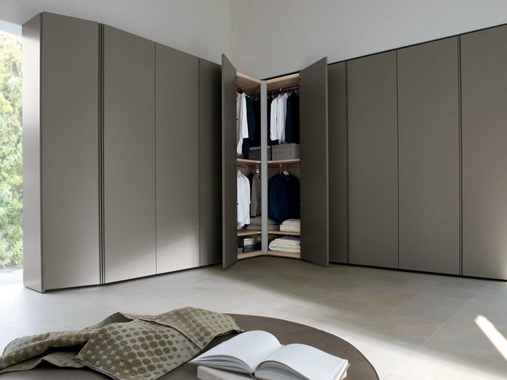 Corner sectional wooden wardrobe design by  Molteni Design Team via archiproducts