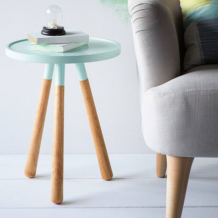 This colour dip side table is an attractive combination of solid rubberwood and crisp colour which is completely on trend .The table has been designed to look like a simple three legged stool with rubber wood legs and a coated white metal table top. It is the perfect size to keep drinks and nibbles nearby while you watch TV, or to put in the hallway to put your mobile and keys on.White mdf and metal table top. Rubberwood feet.H50.8cm (20inches) x 39.4cm diameter (15.5 inches).