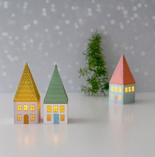 Free printable paper craft! Mini paper houses glowing with LED candle lights