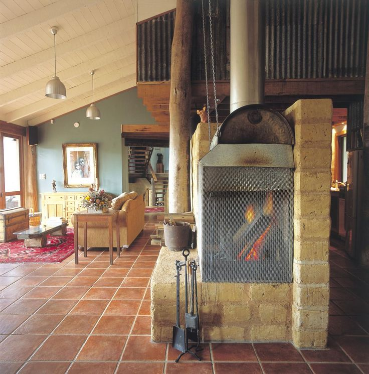 Green, Quirky, Luxury – Straw Bale living-dining at Leura Dairy Blue Mountains | Green City Trips - Ready to go? Check availability and rates http://www.booking.com/hotel/au/old-leura-dairy.html?aid=802126;lang=en or read our review http://greencitytrips.com/eco-friendly-luxury-retreat-old-leura-dairy-blue-mountains/