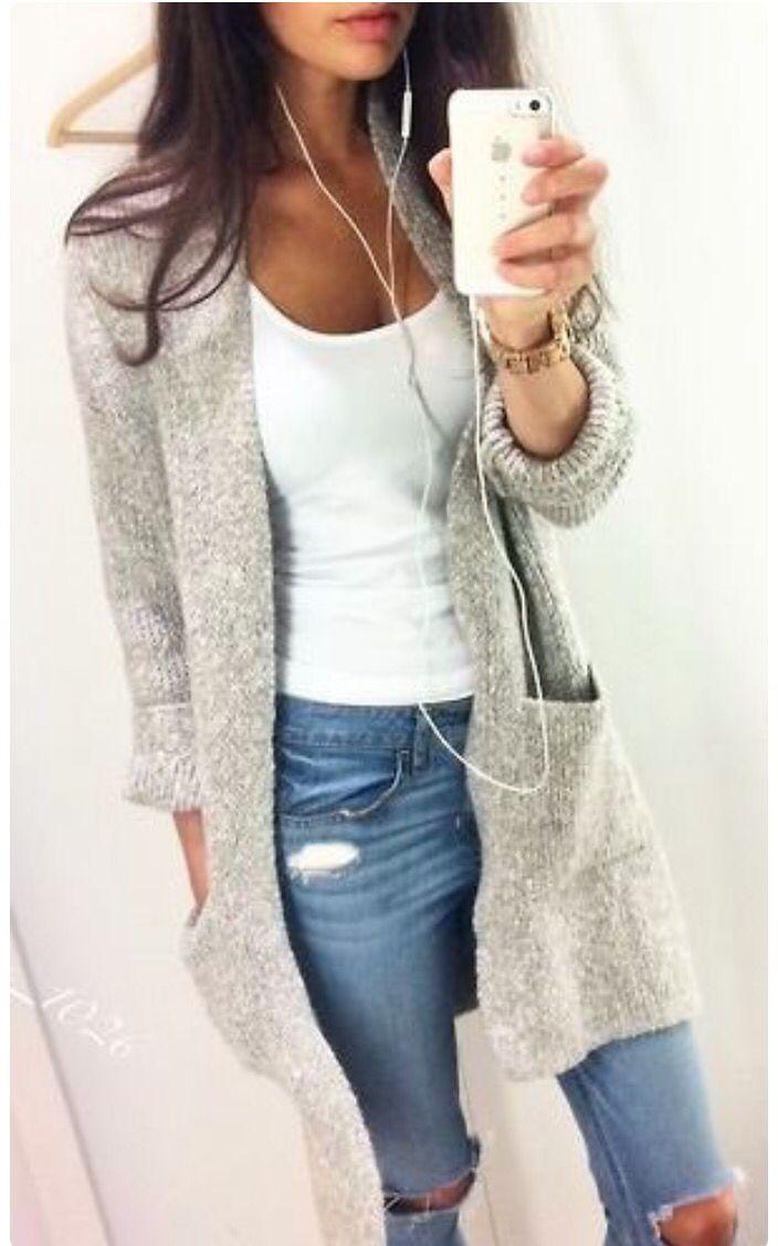 Off duty style. Ripped jeans, white vest, oversized cardigan. Selfie, brunette