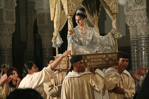 Moroccan Wedding - A traditional Moroccan bride wears an elaborate kaftan (front-buttoned overdress, usually reaching to the ankles, with long sleeves) and heavy jewelry.