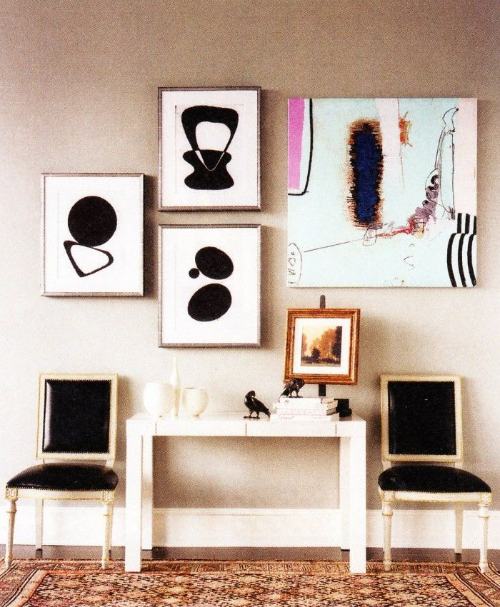 parsons table, black chairs and art