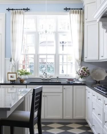 Blue kitchen, black and white tile floor | White house with the red...