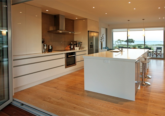 The entertainer's kitchen enjoys views of the ocean.