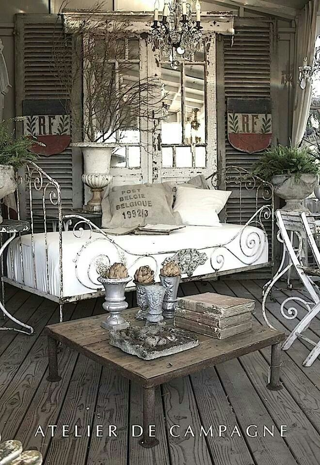 Doors with mirrors, random old shutters - what a beautiful way to decorate a wall.
