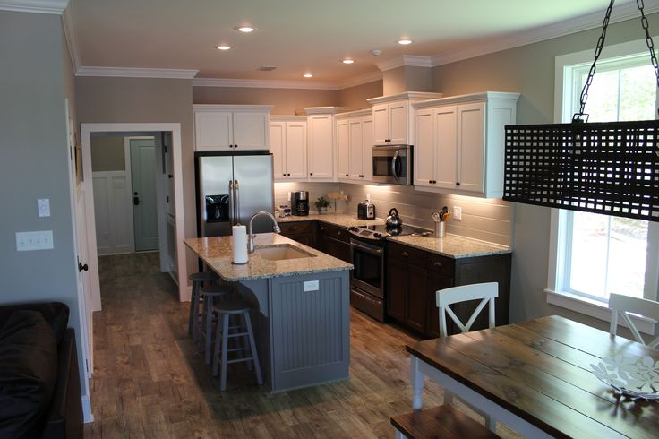 Kitchen With White Painted Upper Cabinets Stained Lower
