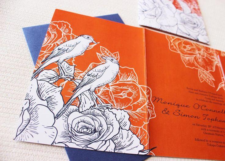 orange wedding invite with birds in navy blue