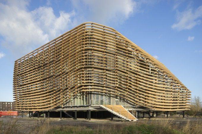 Wavy facade with wooden lammela's at Wetsus Watercampus.