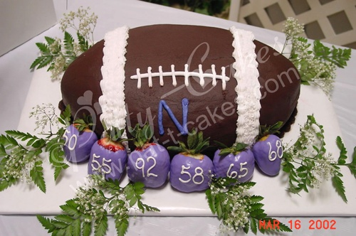 Make him happy with a Football jersey or a cake, more ideas: http://lovendar.com/articles/Top-7-Hand-Held-Snacks-Super-Bowl-Game-Day-Party-Recipes