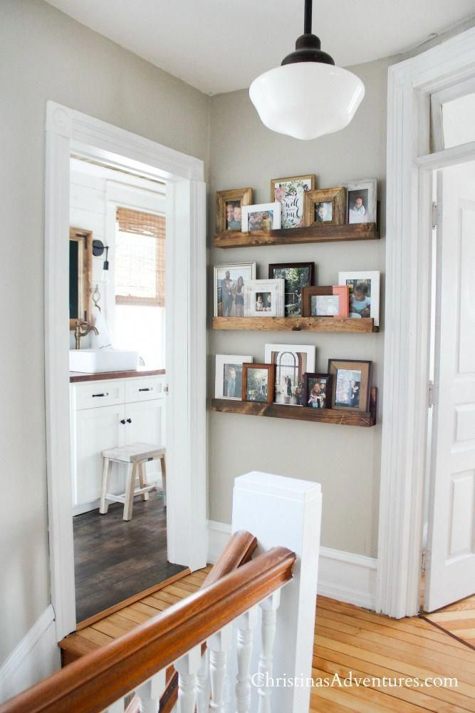 Learn how to make this easy DIY picture ledge on a small budget. Perfect home decor idea for displaying pictures in a hallway!