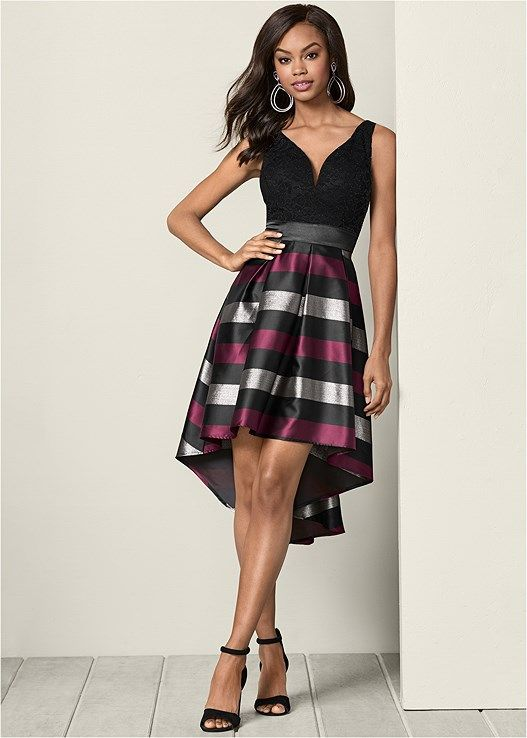 abe9f5ff400bb Mixed media dress offers a little more edge with a lace top and a plaid  high low hem bottom.V-neckNylon metallic fibers spandex with poly  liningImported