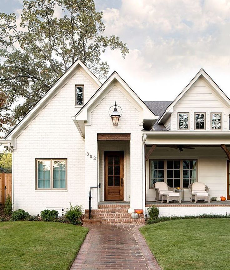 """Oyster White by Sherwin Williams @scoutandnimble """"You gotta love a white brick home, right? And this one by @willowhomesbham is so good! Please tell…"""""""