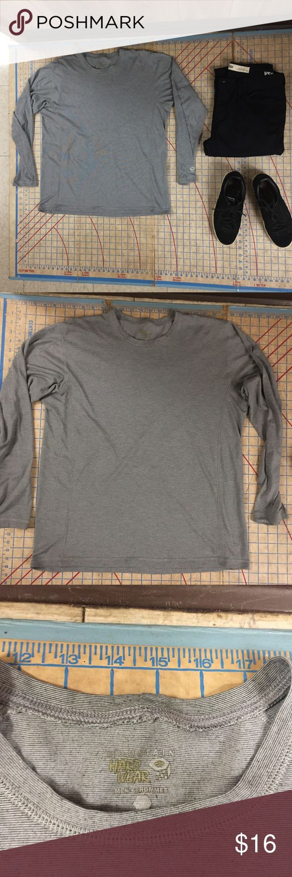 """Mountain Hard Ware long sleeve layering T-shirt Worn very little. Mountain Hard Ware base layer long sleeve crew neck. No size label but think this is a medium. Bought by my man's mother and always fit him a little large. No stains, holes or wear. Great shirt for layering. Wicks sweat from body. Performance shirt perfect for hiking, climbing or running. Shirt is 26"""" in length, 22"""" across chest, and 25"""" down the sleeve. Slightly fitted cut. Mountain Hard Wear Shirts Tees - Long Sleeve"""