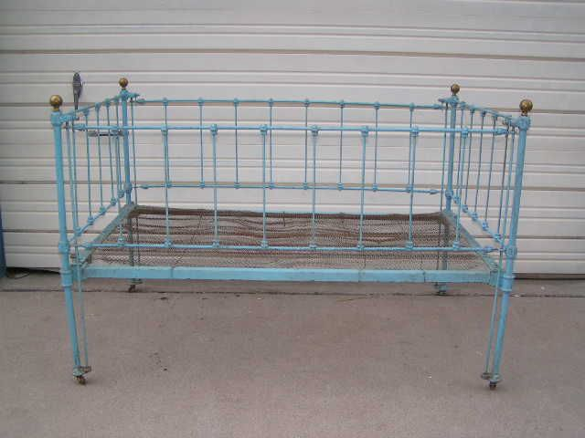 This Is An Antique Cast Iron Baby Bed With Brass Knobs On