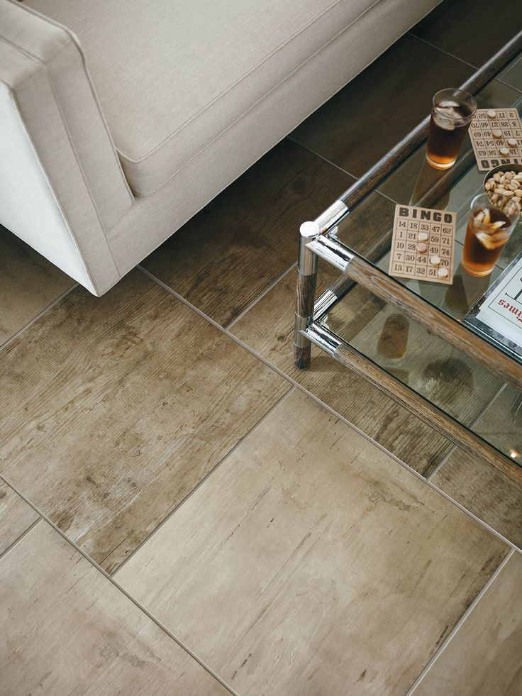 I am loving the reclamation line from Crossville.  This would be very cool in a bright, cozy, non-traditional dining or family room.   Crossville Porcelain Tile - Reclamation Whiskey Etching