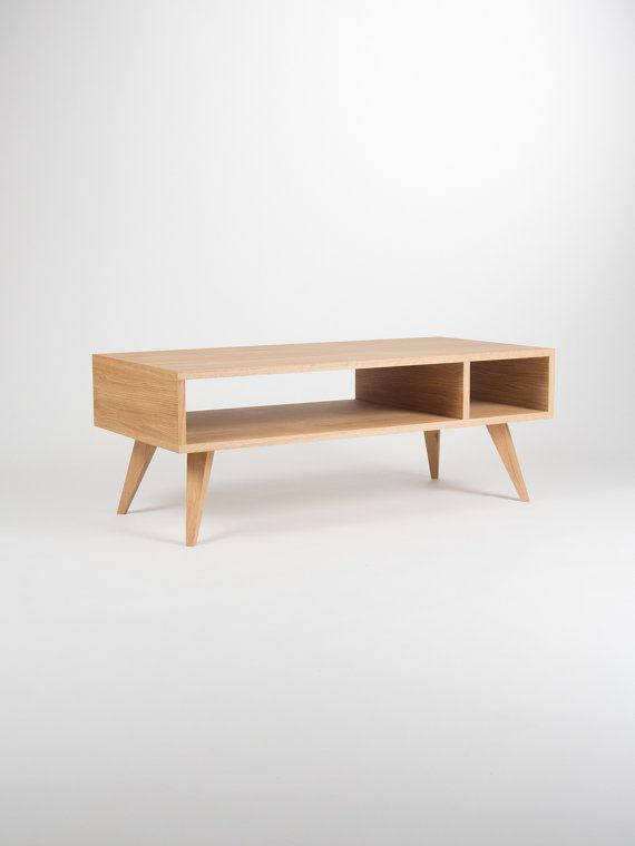 Our coffee table / TV stand is a piece of furniture, which thanks to its gentle form - inspired by the mid-century modern Scandinavian design - offers various applications. Its symmetry opens another, new possibilities - you can place it next to the wall or in the middle of the living room. Our table, made of solid oak wood and wood covered with natural oak veneer, has been perfectly finished with hard oil wax. This type of finishing allows the wonderful grain patterns to shine through and…