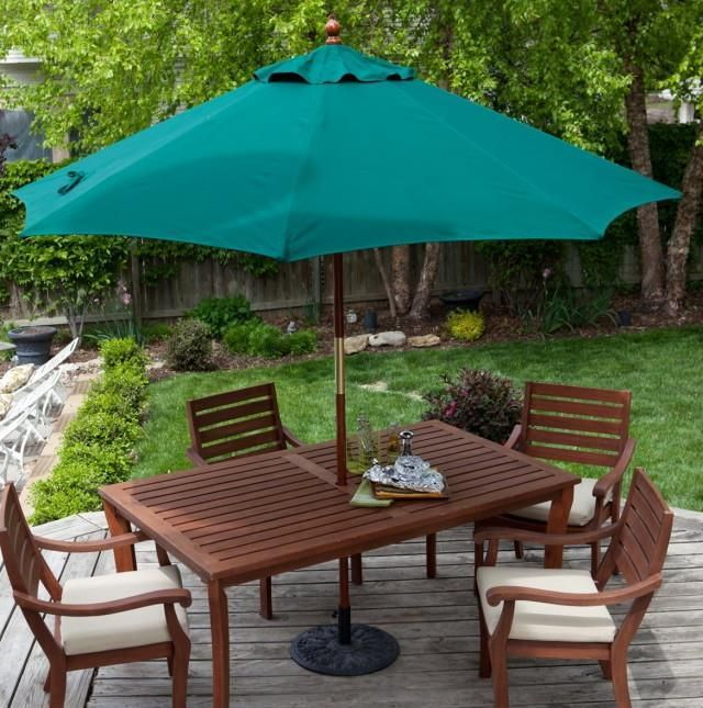 outdoor brown conventional varnished wooden dining set with green patio umbrella also cheap patio furniture sets