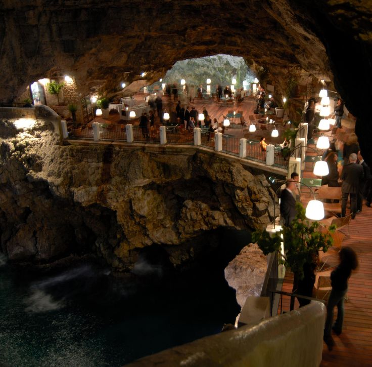 The elegant and atmospheric Grotta Palazzese restaurant tucked inside a cave at Puglia, open May to October